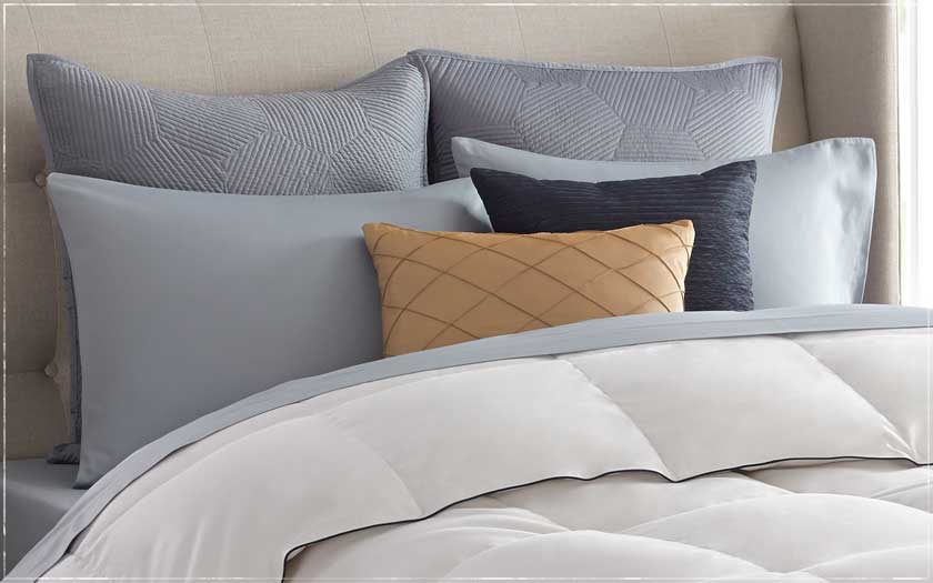 White Quilt Bedding With Accent Pillows