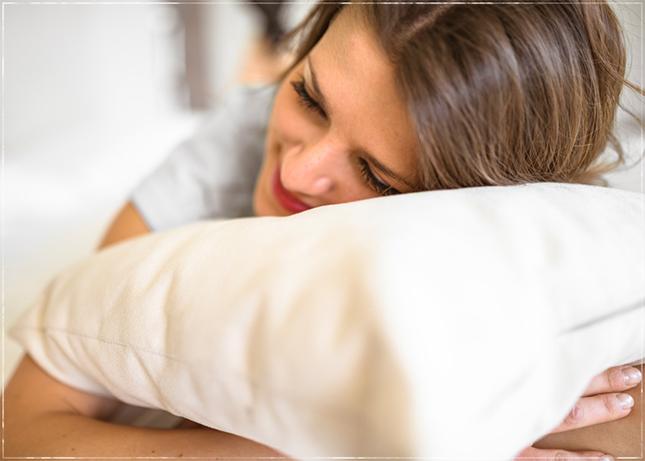 Women holding pillow