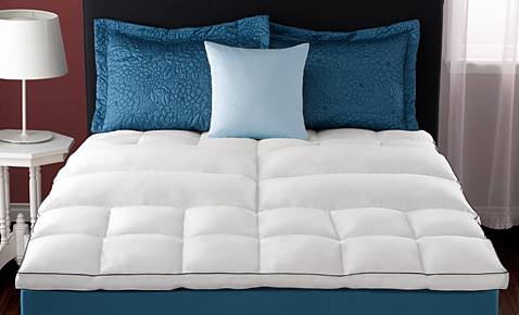 A comforter on bed