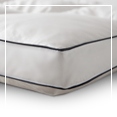 Our gusseted pillow and feather bed designs are made by sewing a small strip of fabric -- 1/2 to 3 inches wide -- between the top and bottom cover of the product.