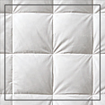 In our traditional sewn through box design, the top and bottom fabric layers of the comforter or blanket are sewn or quilted together in a large grid pattern. This design feature keeps the down in place and prevents it from shifting from one box to another.